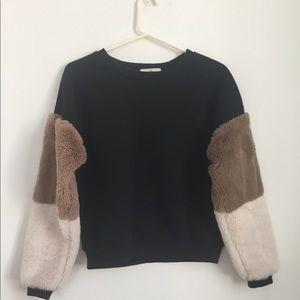 Black sweatshirt with faux fur sleeves